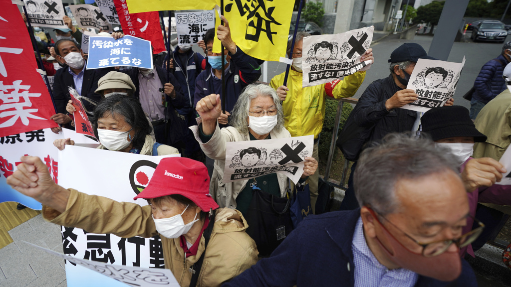 People in Tokyo protest a decision to start releasing into the ocean massive amounts of treated wastewater from the Fukushima nuclear plant. The plant was damaged in a 2011 earthquake and tsunami.