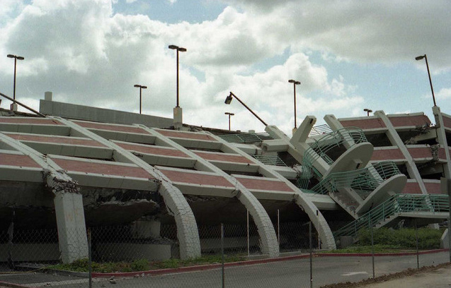 A concrete parking structure caved into itself during the earthquake.