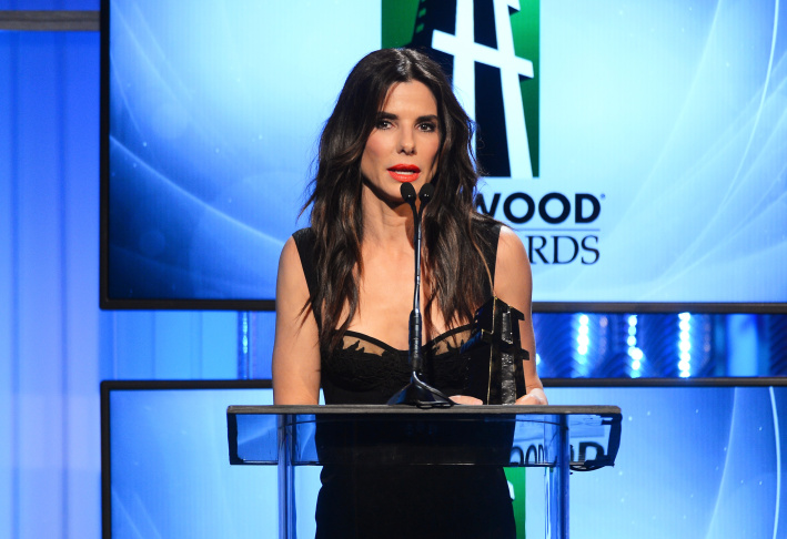 Actress Sandra Bullock accepts the Hollywood Actress Award for 'Gravity' onstage during the 17th annual Hollywood Film Awards at The Beverly Hilton Hotel on October 21, 2013 in Beverly Hills, California.