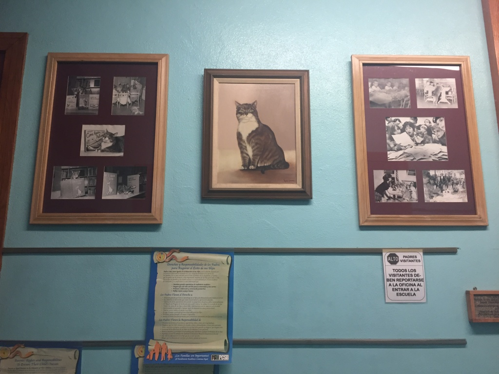 Press Clippings and a painting of Room 8 line the halls at Elysian Heights Elementary School.