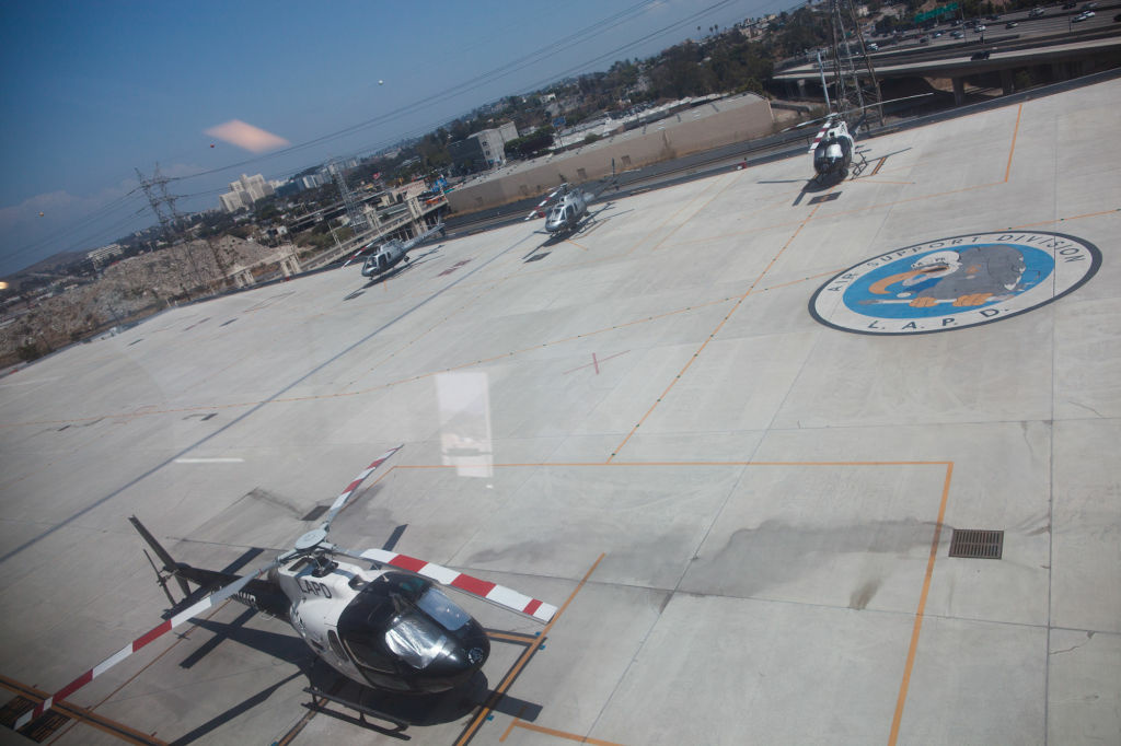 Helicopters parked on the tarmac on the top floor of a facility near the Men's Central Jail in downtown Los Angeles. Anyone who steps on the squadron's logo has to do 50 pushups.