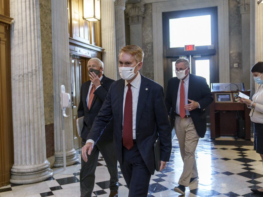 Sen. James Lankford, R-Okla., center, is among the Republican lawmakers supporting a push for President-elect Joe Biden to receive new intelligence briefings as part of his transition to the White House.