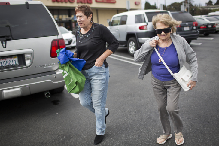 Roommates Shirley Ross, 95, left, and Lois Rubin, 66, grocery shop on Monday afternoon, July 6, 2015. Ross and Rubin are two of many seniors around Los Angeles who are living together as a way to save money.