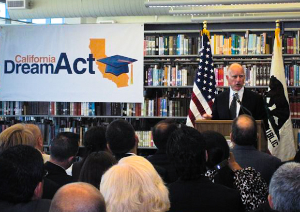 California Governor Jerry Brown speaks to a crowd before signing AB 130.