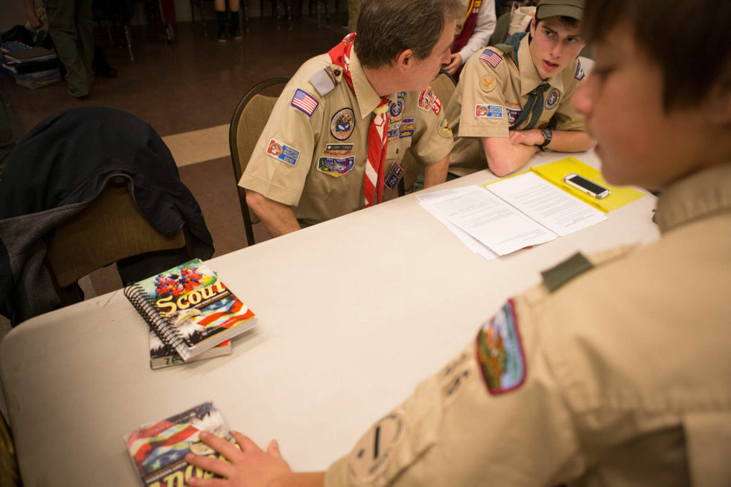 Brandon Lampert, right, receives some advice on how to complete a project from Scoutmaster Larry Turner.