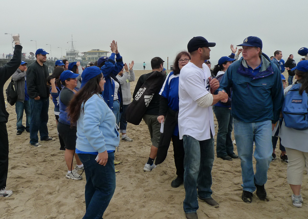Mark Gold (in navy windbreaker at far right) got Dodgers to clean up beaches.