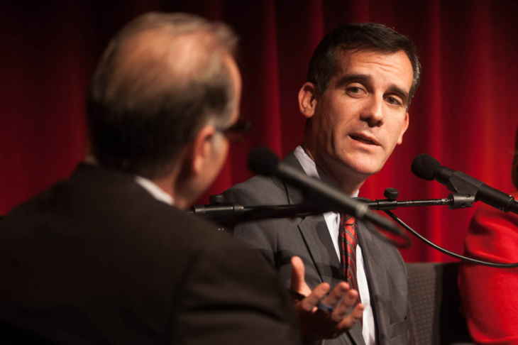 Larry Mantle (far left) moderates a debate between mayoral canidates (from right) Emanuel Pleitez, Jan Perry, Kevin James, Wendy Greuel and Eric Garcetti at KPCC's Crawford Family Forum on February 5, 2013.