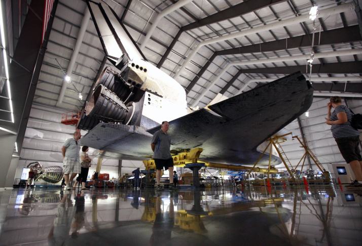 The payload bay doors of the space shuttle Endeavour, housed at the California Science Center, stand open after the installation of a space lab and storage pod on Friday, Oct. 10, 2014 in Los Angeles. The equipment being installed was flown on some missions. A crew on Thursday delicately positioned the 3,000-pound (1,360-kilogram) portable lab and pod inside the orbiter's huge cargo bay. Workers also installed a replica robotic arm, airlock and docking system.