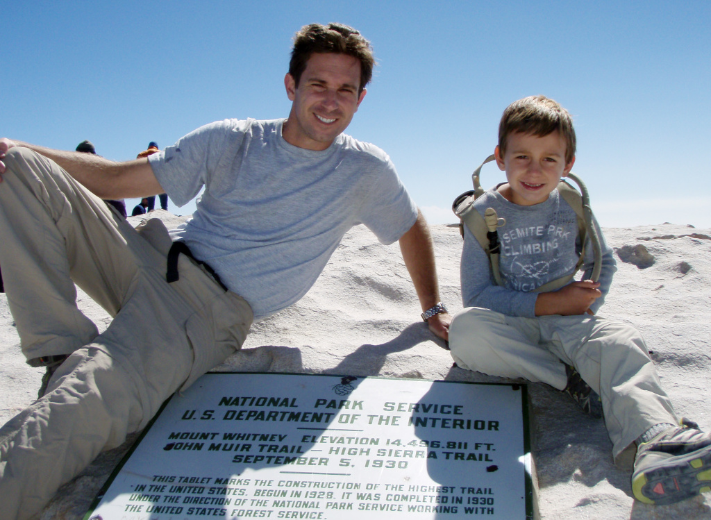 FILE - This July 26, 2011 file photo provided by Kevin Armstrong, shows Kevin and his son, Tyler Armstrong, 7, after reaching the summit of Mount Whitney in the Sierra Nevada, Calif.  On Wednesday, Dec. 25, 2013, Tyler, now 9, became the youngest person in recorded history to reach the summit of Argentina's Aconcagua mountain.