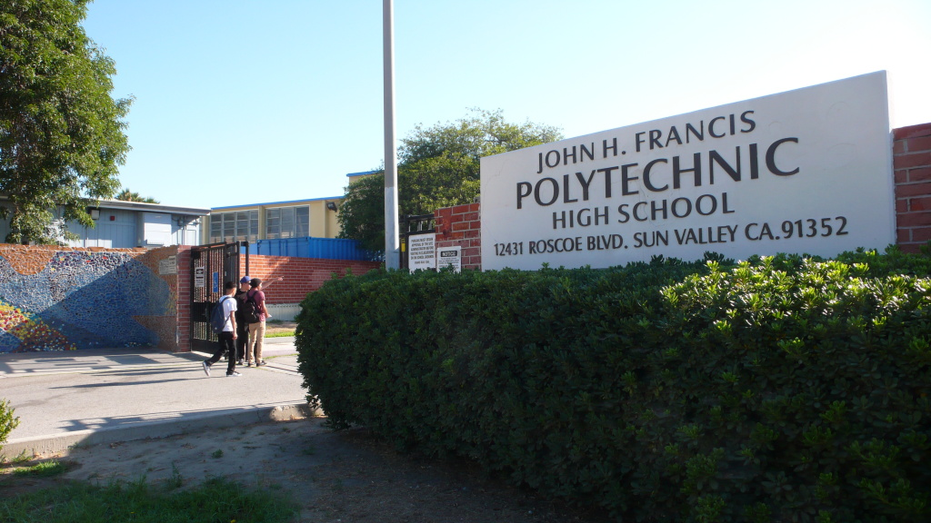 Students file into John H. Francis Polytechnic High School for the first day of summer school.