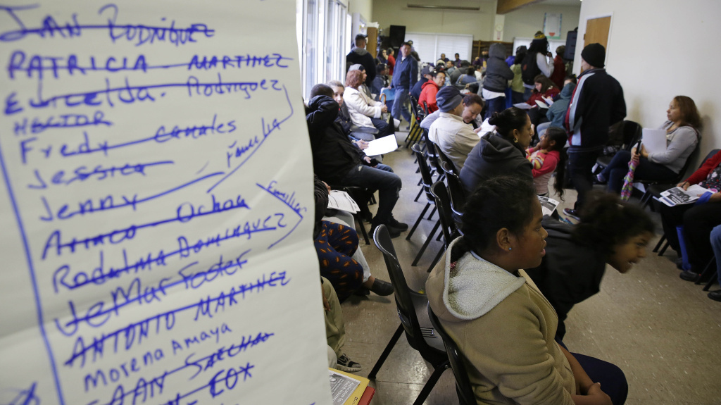 Last-minute applicants for health insurance jam the Bay Area Rescue Mission in Richmond, Calif., in April.