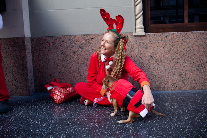 A long-haired Santa strays from the pack that attended SantaCon.