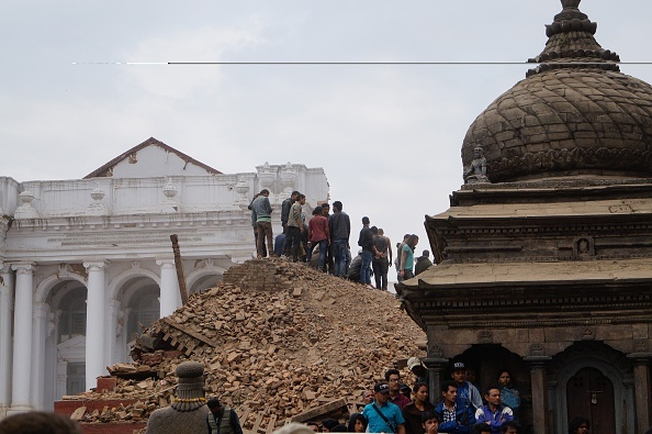 KATHMANDU, NEPAL - APRIL 25 : Local people help with rescue work at the site of a building that collapsed after an earthquake in Kathmandu, April 25, 2015. (Photo by Sunil Pradhan/Anadolu Agency/Getty Images)