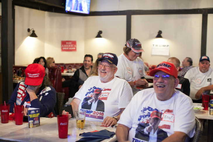 Melody Reid, left, watches the second presidential debate at JJ's Bar & Grill in Santa Clarita, California, on Sunday, Oct. 9, 2016.