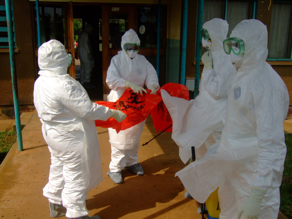 Officials from the World Health Organization wear protective clothing on July 28, 2012 as they prepare to enter Kagadi Hospital in Kibale District, about 200 kilometres from Kampala, where an outbreak of Ebola virus started.