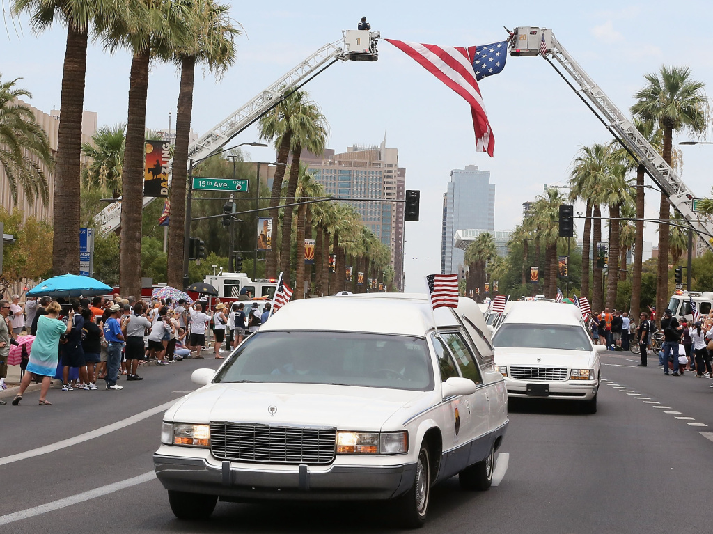 On Sunday in Phoenix, the 19 bodies of firefighters killed while battling a wildfire in central Arizona were driven to Prescott, where the