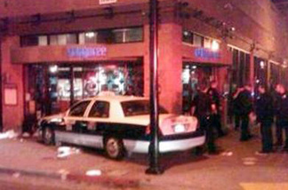 This image provided by the San Diego Fire and Rescue Department shows the scene where according to police, a taxi cab driver plowed slowly into a crowd on a sidewalk in San Diego's busy Gaslamp District Saturday Feb. 12, 2011, injuring more than two dozen people.