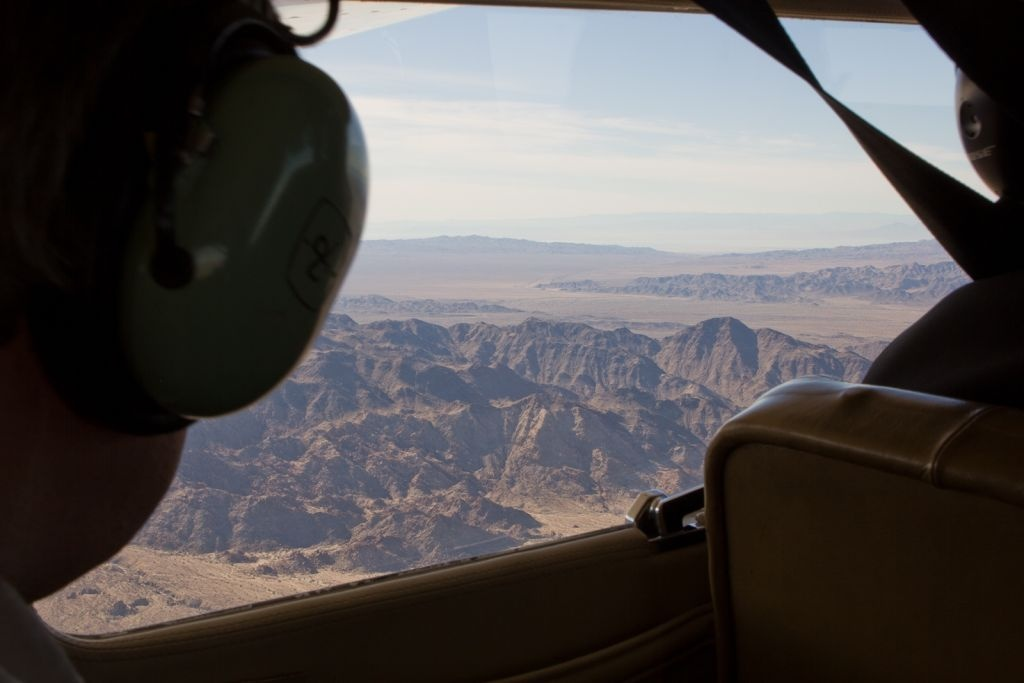 The little San Bernardino Mountains are visible over the shoulder of one of the other 5 people in the 6 seat plane.