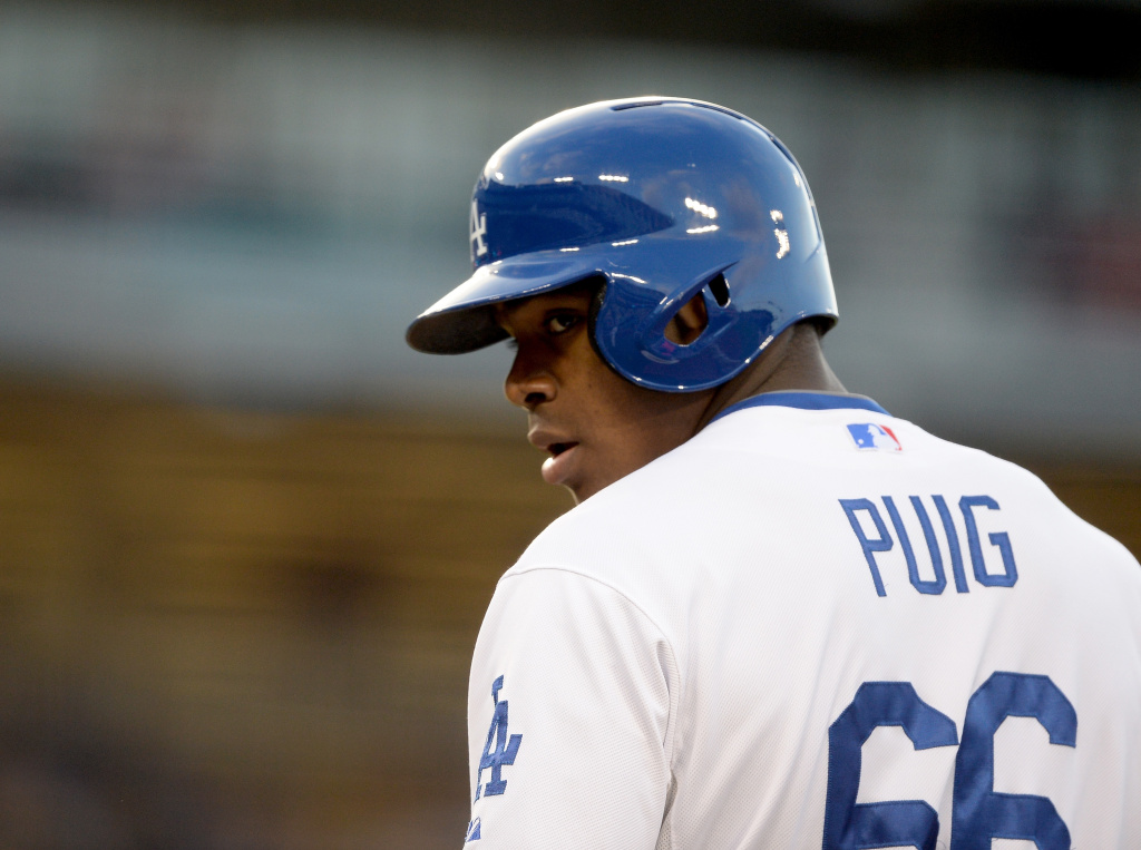 Yasiel Puig #66 of the Los Angeles Dodgers on first base after his single in his major league debut against the San Diego Padres during the first inning at Dodger Stadium on June 3, 2013 in Los Angeles, California. Since June 22nd, the Dodgers have won 33 of their last 47 games