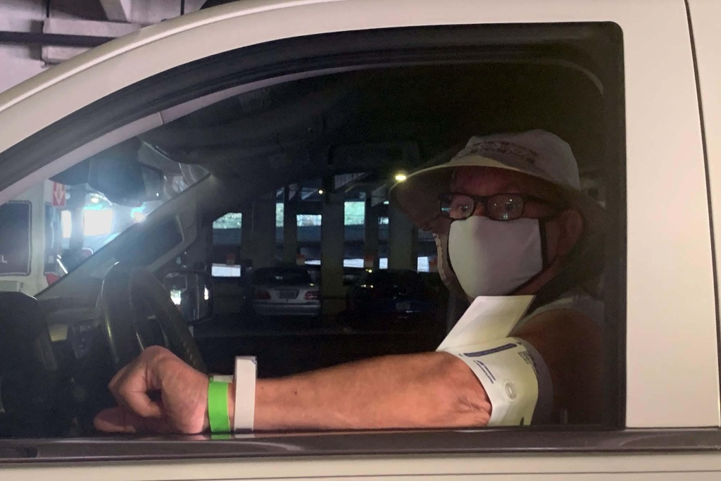 Veteran David Tootle pulls into the Tampa VA parking garage to be seen for back pain.