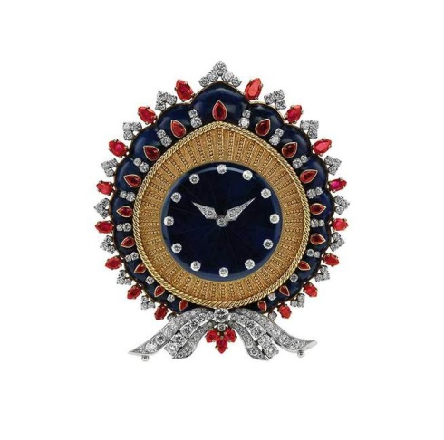 Sautoir, 1969. Platinum with sapphires and diamonds. Chain: 74 x 1 cm. Pendant/brooch: 4.9 x 4.9 cm. Formerly in the collection of Elizabeth Taylor. Bulgari Heritage Collection, inv. 6675 N2170 © Antonio Barrella Studio Orizzonte