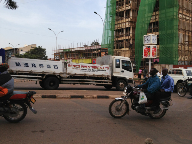 China's influence is visible on the streets of Kampala where Chinese contractors are building several high-rises.