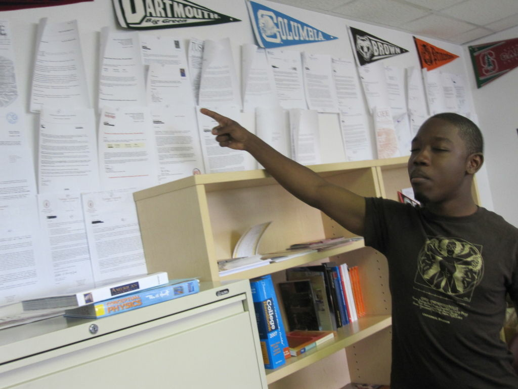 Douglass Academy 12th-grader David Berry points to lots of acceptance letters in the high school's college counseling office.