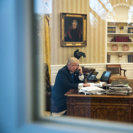 President Donald Trump speaks on the phone with Australian Prime Minister Malcolm Turnbull. Also pictured at right, National Security Advisor Michael Flynn and White House Chief Strategist Steve Bannon.