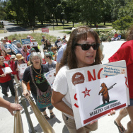 Yolanda Sanchez, left,and her daughter, Michele Sanches-Nelson, a registered nurse, wait in line with other members of the California Nurses Association and supporters to enter the Capitol to call for a single-payer health plan, Wednesday, June 28, 2017, in Sacramento, Calif. The demonstrators were demanding that Assembly Speaker Anthony Rendon, D-Paramount, bring a health care bill, SB562, by state Senators Ricardo Lara, D-Bell Garden, and Toni Atkins, D-San Diego, to a vote in the Assembly. (AP Photo/Rich Pedroncelli)