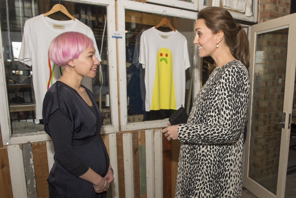 Britain's Catherine, Duchess of Cambridge (R), talks to pregnant artist Heidi Plant about baby dates and art during a visit of the Resort Studios in Margate, southern England on March 11, 2015.
