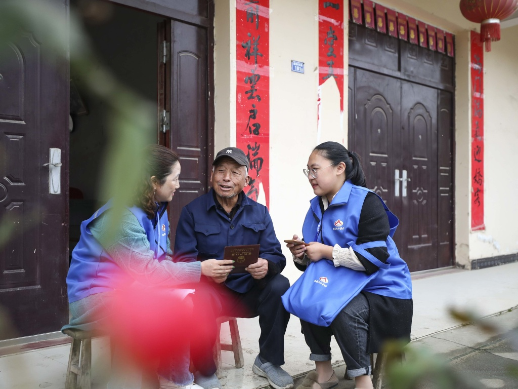 Workers in China collect demographic data in the the seventh population census on Nov. 1, 2020.