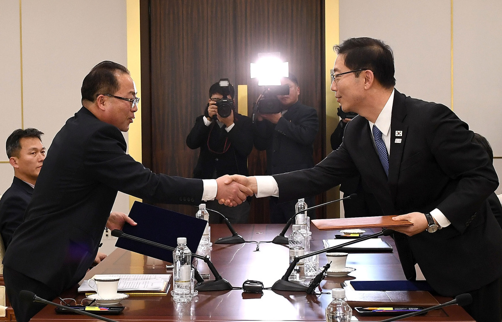 In this handout image provided by the South Korean Unification Ministry, South Korean Vice Unification Minister Chun Hae-Sung, (R) shakes hands with the head of North Korean delegation Jon Jong-Su (L) after their meeting on January 17, 2018 in Panmunjom, South Korea.