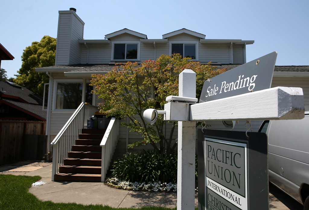 A sale pending sign is posted in front of a home for sale on July 2, 2013 in San Anselmo, California. Southern California's median home sale price hit $400,000 in March to set a fresh six-year high as tight supplies limited sales, a research firm said Tuesday.