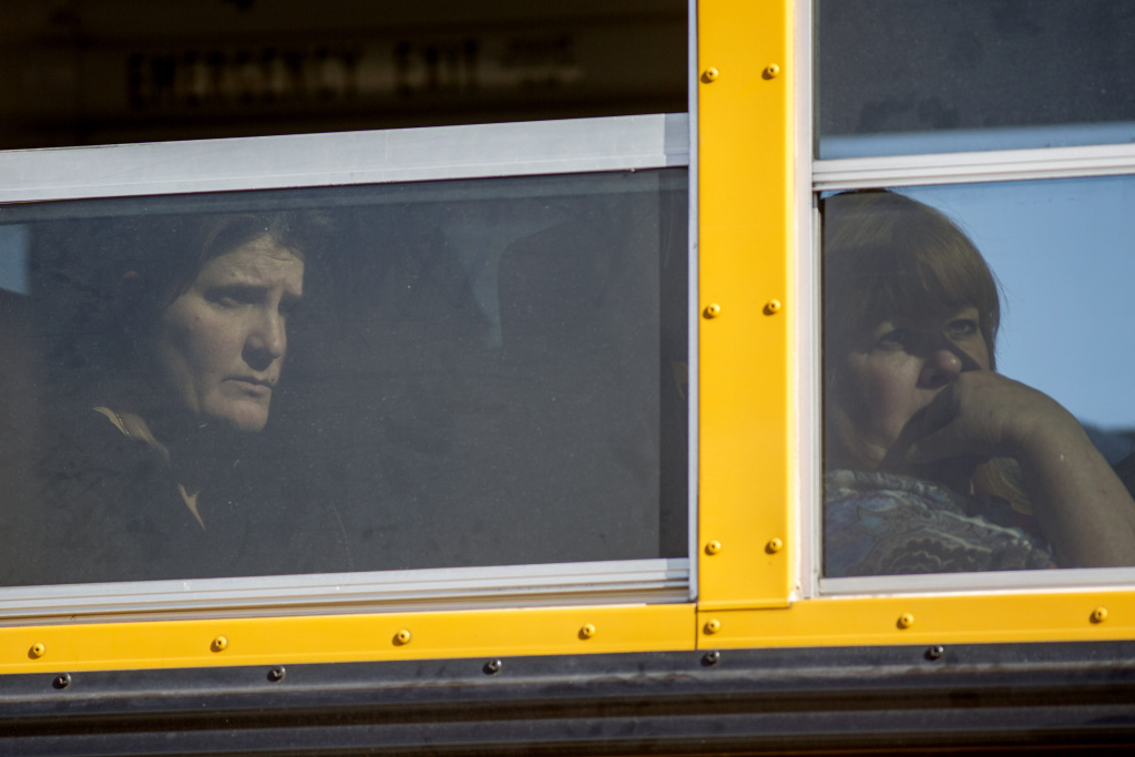 FILE: Employees and other people are evacuated by bus from the site of a mass shooting at the Inland Regional Center Dec. 2, 2015 in San Bernardino, California.