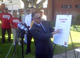 Kurt Owens with the Bell Police Officers Association at a news conference Oct. 28, 2010 displaying an email former city manager Robert Rizzo apparently sent requesting a boost in pay for Lieutenant Ty Henshaw.