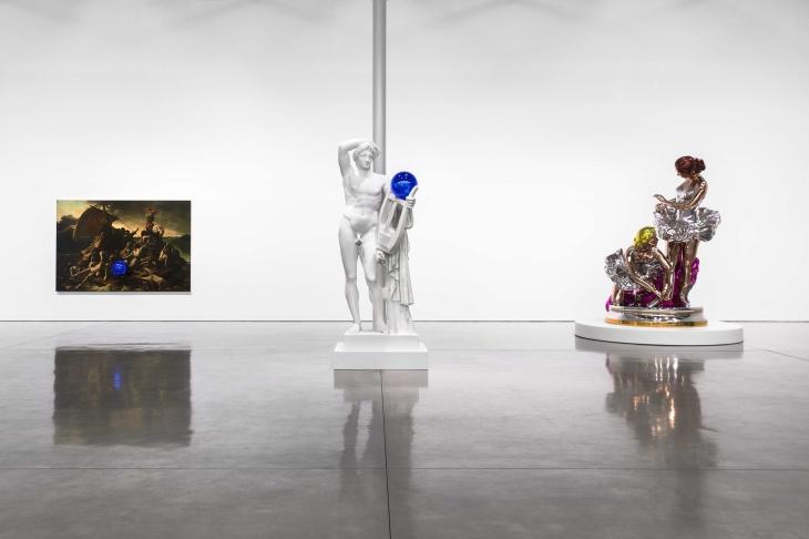 Artist Jeff Koons stands with his Gazing Ball sculptures.