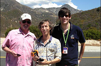 Near the end of their Off-Ramp TemperaTour, JPL climatologist Bill Patzert, Cal State LA meteorologist Steve LaDochy, and KPCC's John Rabe (L-R) discover it's just as hot up on the Angeles Crest, as evidenced by the big cumulus clouds.