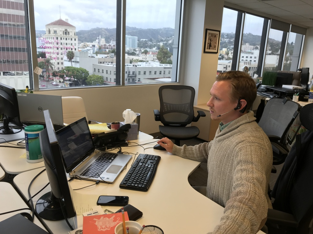 Recruiter Matt Stone calls job-seekers from his desk at the Hollywood office of Proven Recruiting, May 1, 2018.
