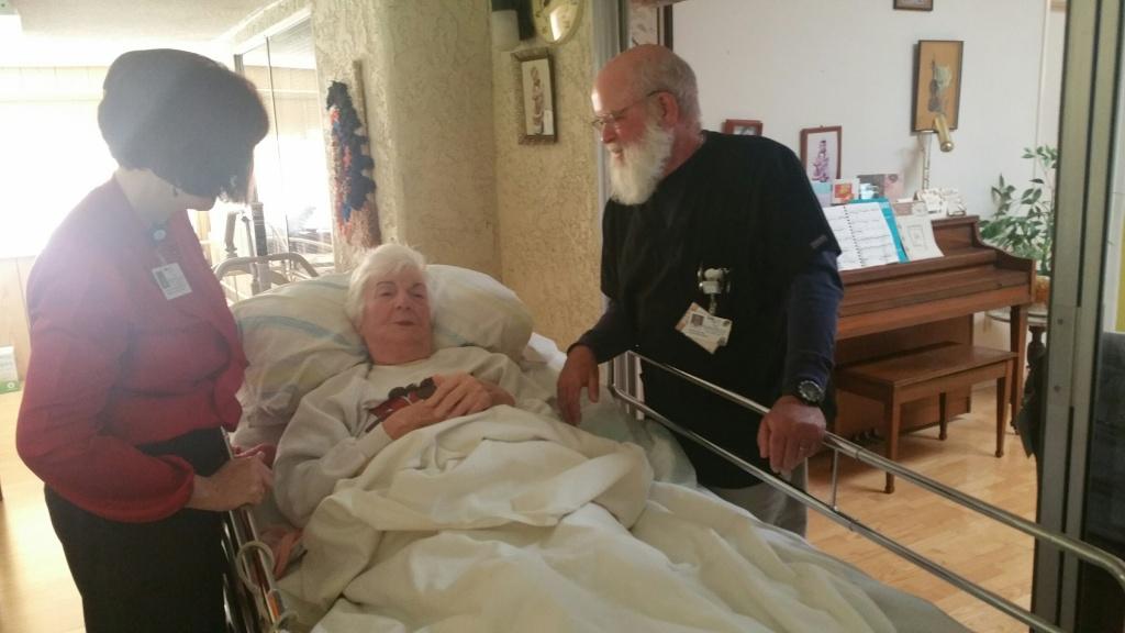Hospice nurse Kurt Rice (right) and Teri Helton (left), program manager for Livingston Memorial Visiting Nurses Association, visit Shirley Sarah Heller in her Leisure Village home in Camarillo.