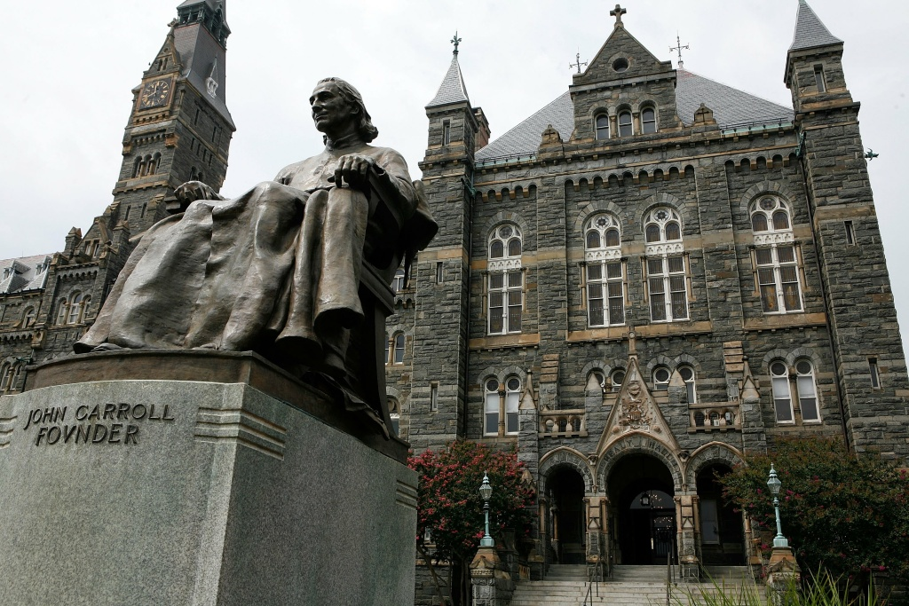 A statue of John Carroll, founder of Georgetown University, sits before Healy Hall on the school's campus August 15, 2006 in Washington, DC.