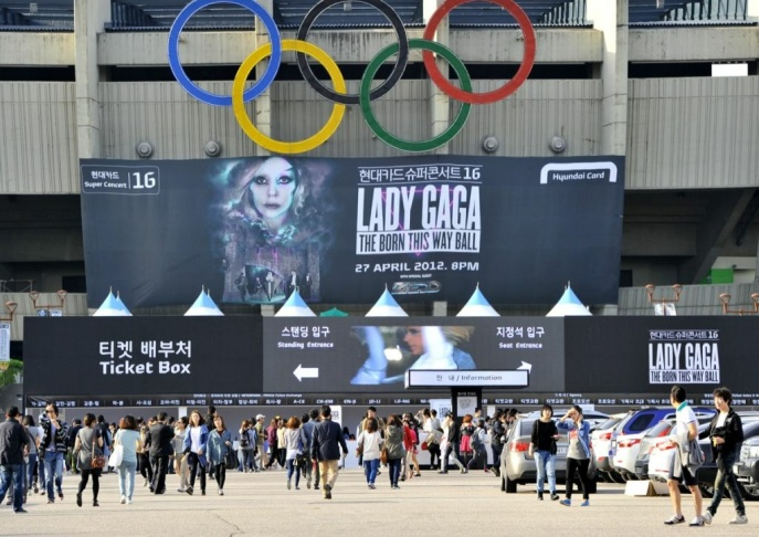 A protestors holds a placard against Lady Gaga ahead of her concert outside Seoul's Olympic Stadium on April 27, 2012. Tens of thousands of South Koreans flocked to the opening show of Lady Gaga's global tour on April 27, amid colourful scenes as female and male fans donned outrageous outfits in honour of the US pop diva.