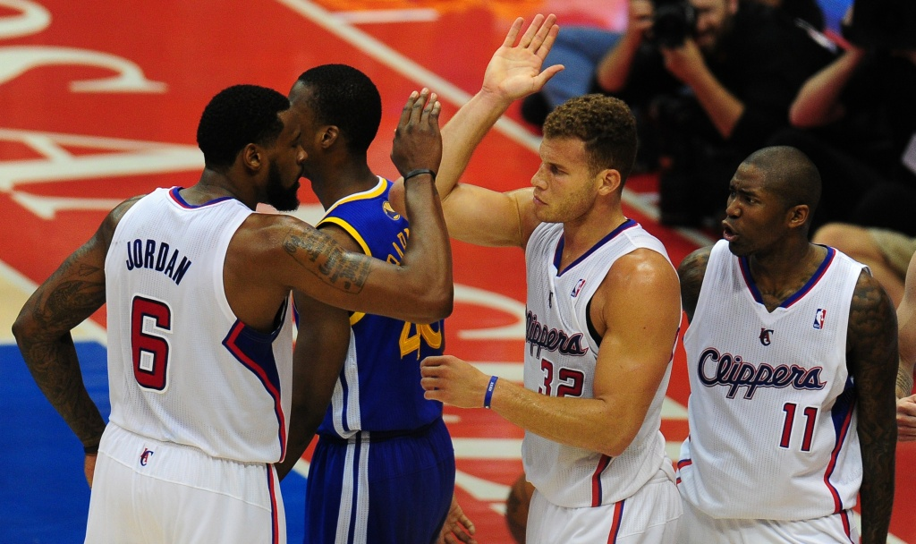Blake Griffin of the Los Angeles Clippers celebrates with teammate deAndre Jordan after drawing a foul while scoring against the Golden State Warriors during game 7 of their NBA first round series on May 3, 2014 in Los Angeles, California, where the LA Clippers defeated the GS Warriors 126-121.
