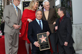 Maestro Zubin Mehta (L front row) and Leron Gubler/Emcee: Hollywood Chamber of Commerce, President/CEO, (from left back row) Sam Smith, Mrs. Zubin Mehta and actor Kirk Douglas pose for photographers during the installation ceremony for Zubin Mehta's star on the Hollywood Walk of Fame on March 1, 2011 in Hollywood, California.