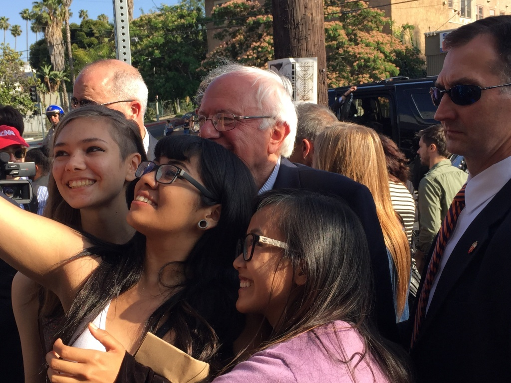 Presidential candidate Bernie Sanders poses for pictures with fans in Silver Lake.
