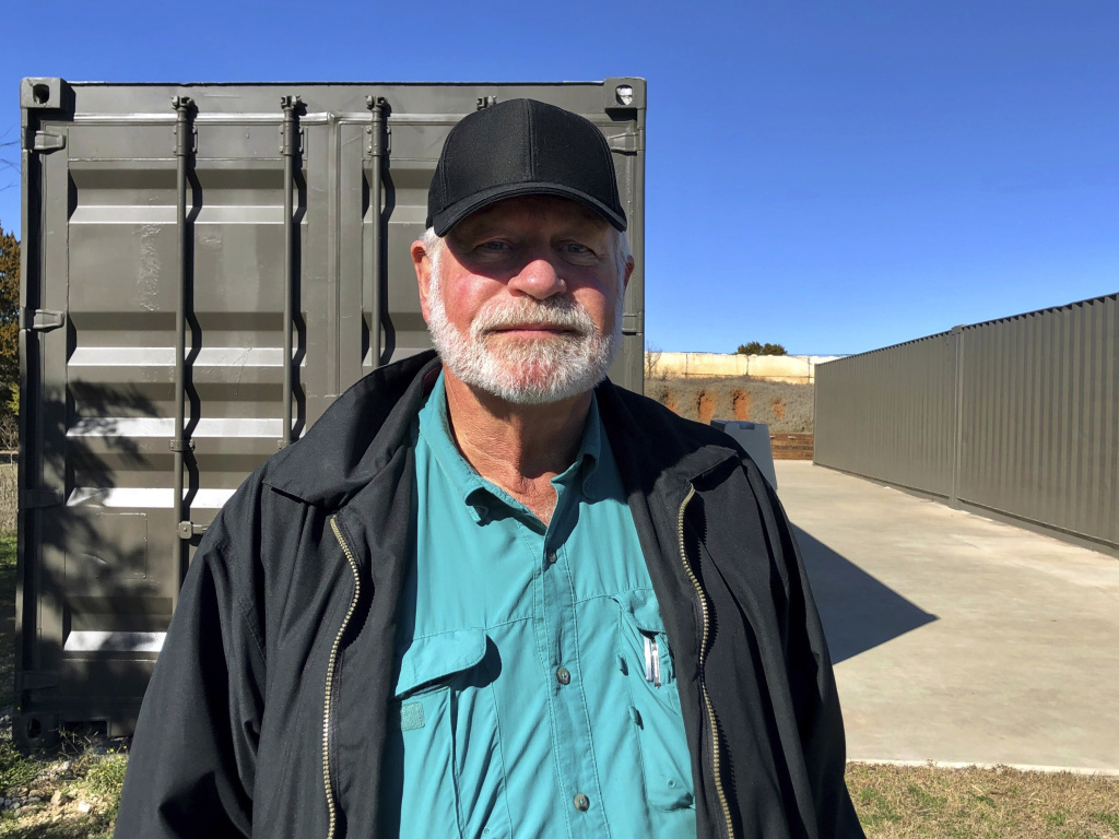 Jack Wilson poses for a photo at a firing range outside his home in Granbury, Texas. Wilson, who trains the volunteer security team of the West Freeway Church of Christ, killed a man who fatally shot two people there on Dec. 29.