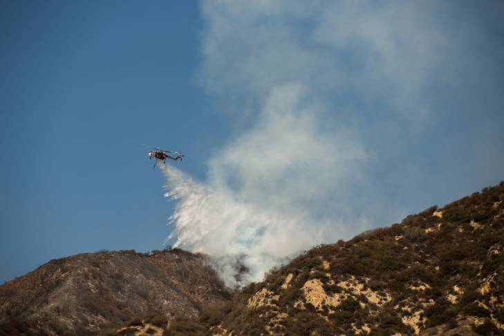 A helicopter fights the Madre Fire on a ridge near Azusa on September 24th, 2014.
