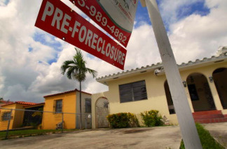 A pre-foreclosure sign is seen in front of a home in Miami, Florida.