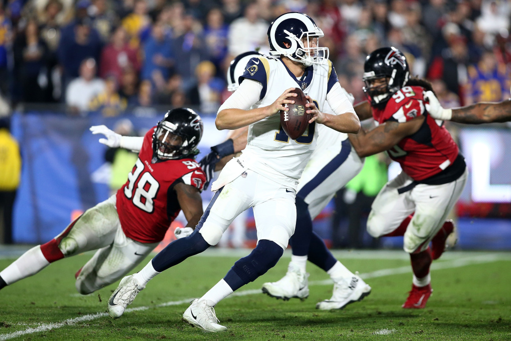 LOS ANGELES, CA - JANUARY 06:  Jared Goff #16 of the Los Angeles Rams scrambles during the NFC Wild Card Playoff Game against the Atlanta Falcons at the Los Angeles Coliseum on January 6, 2018 in Los Angeles, California.  (Photo by Sean M. Haffey/Getty Images)