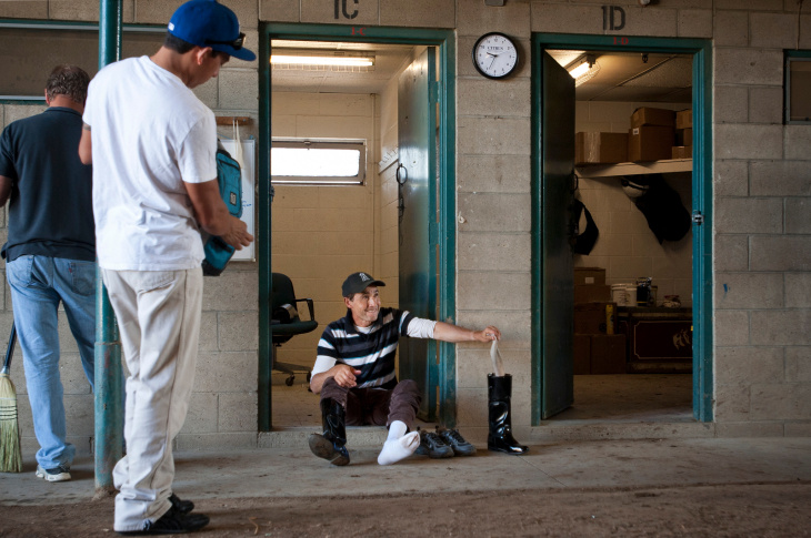 Groomer Byron Vasquez of Cerin Racing Stables washes a racehorse after a run on Friday morning at Hollywood Park Race Track. Each season, the team moves their staffers and horses to a different track. Cerin Stables just transported their 35 racehorses from Santa Anita.
