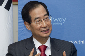South Korean Ambassador to the United States Han Duk-Soo speaks during a panel discussion sponsored by Third Way discussing the US-Korea Free Trade Agreement with US Trade Representative Ambassador Ron Kirk at Union Station in Washington, DC, January 13, 2011.